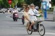 Từ 1/7, đi xe đạp điện phải đội mũ bảo hiểm